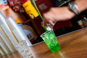 Pouring green rum